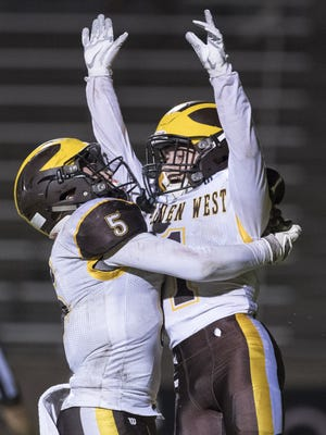 Golden West's Christian Ortiz and Ian Kelly celebrate after a play in a West Yosemite League game on Friday, October 27, 2017.
