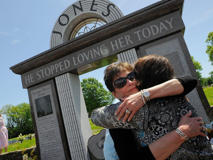 Nancy Jones received George's fans at his grave site after two trees were planted at Jones' memorial at Woodlawn Cemetery to honor him one year after his death. Nancy organized the event and has asked fans to attend. Saturday April 26, 2014, in Nashville, TN.