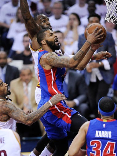 The Detroit Pistons' Marcus Morris scores over the