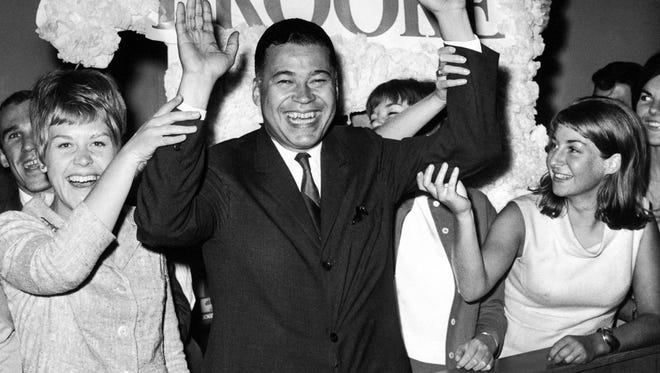 This Sept. 14, 1966, file photo shows Edward W. Brooke joining campaign workers in celebration, in Boston, after winning the Republican nomination for U.S. Senate.