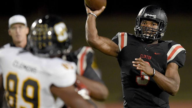 Clinton quarterback Cam Akers (3) throws a first-quarter touchdown against Starkville on Friday.