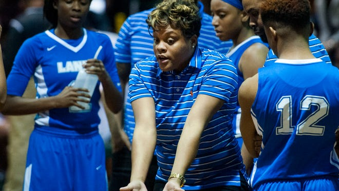 Lanier coach Courtney Ward coaches against Jeff Davis on the JD campus in Montgomery, Ala., on Friday January 27, 2017.