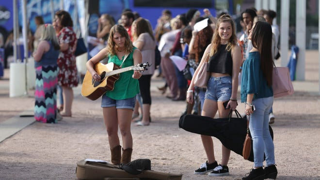 Contestants wait in line in line during the American Idol auditions at Louisville's Waterfront Park. Aug. 30, 2017