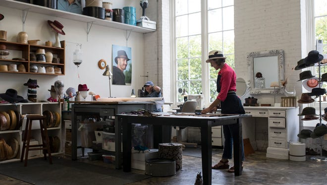 Milliner Sarah Havens works on cutting materials for hats inside the Louisville Bespoke space at the Hope Worsted Mills building in the Germantown neighborhood. Aug. 29, 2017