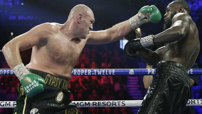 Tyson Fury, left, will probably fight Deontay Wilder, right, before turning his attention to fellow Briton Anthony Joshua next year.