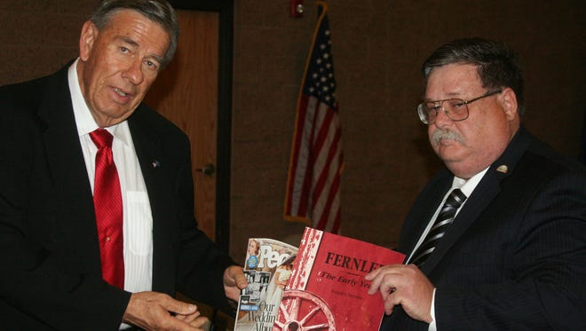 Outgoing Mayor LeRoy Goodman and Mayor-elect Roy Edgington on Nov. 19 place items in the time capsule the city of Fernley is preparing that will be opened in 2051 on the city's 50th anniversary of incorporation.