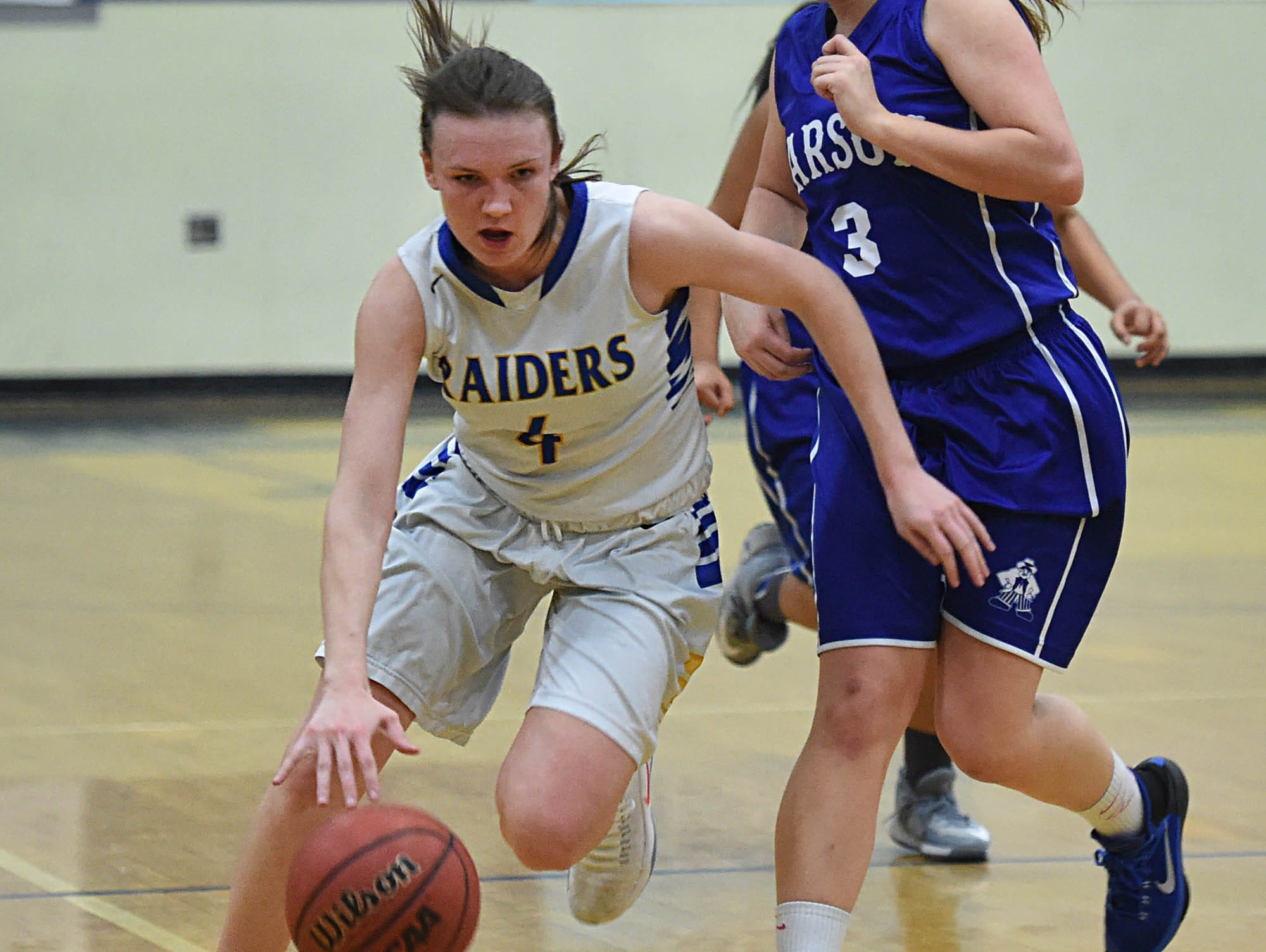 Reed's Taylor Johnson drives to score after stealing the ball from Carson's Bella Kordonowy at the end of the first half of Wednesday's playoff game at Reed.