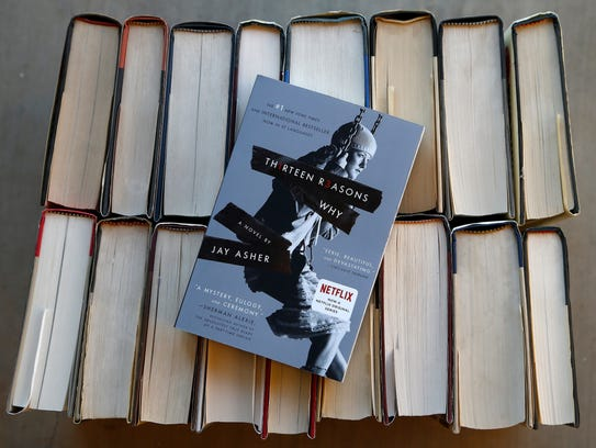 """This photo shows the book """"Thirteen Reasons Why"""" in"""