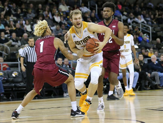 Northern Kentucky Norse forward Carson Williams (23) splits two defenderss into the lane in the second half during the college basketball game between the IUPUI Jaguars and the Northern Kentucky Norse, Thursday, Dec. 28, 2017, at BB&T Arena in Highland Heights, Ky.