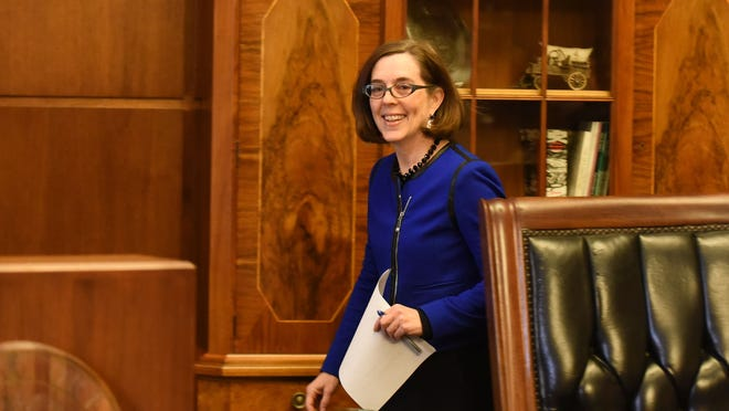 Gov. Kate Brown makes an entrance during a press conference on Friday, Feb. 20, at the Capitol.