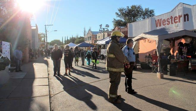 In this 2016 file photo, Tularosa residents walk Granado Street during the Halloween on Granado Street festival.