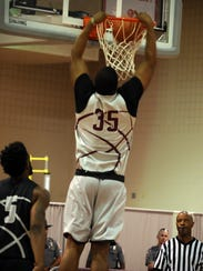 Eastern Shore big man Isaac Taylor goes up for a dunk