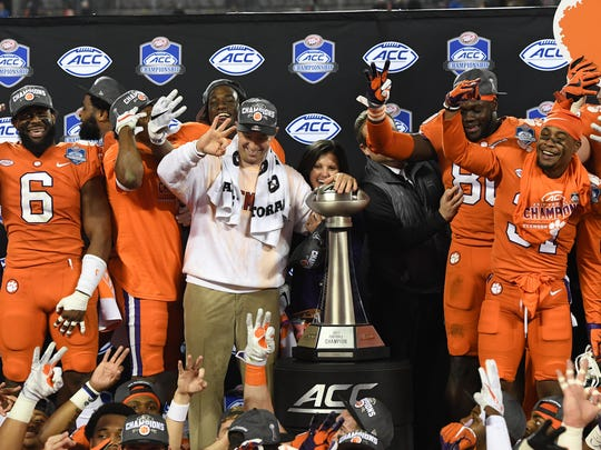 Clemson head coach Dabo Swinney celebrates with his team after their 38-3 ACC championship win over Miami at Bank of America Stadium in Charlotte on Saturday, December 2, 2017.