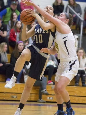 Amy Weisse (10) and Indian Hills defeated Paramus, 58-35, on opening night.