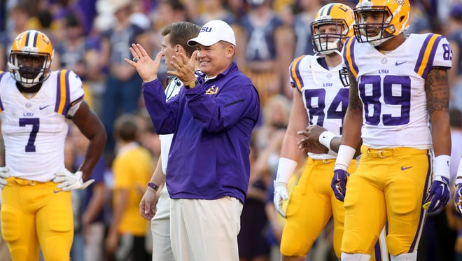 LSU Tigers head coach Les Miles claps for his team during pregame warm ups on the field prior to kickoff against the Mississippi Rebels at Tiger Stadium. LSU defeated Mississippi 10-7.