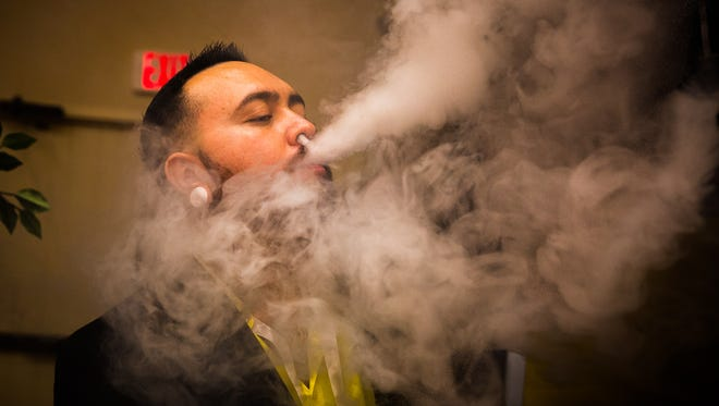 South West Vape owner Ray Vigil tries the cannabis compound Cannabidiol during the Southern New Mexico Medical Cannabis Expo at the Hotel Encanto de Las Cruces, June 24, 2016.