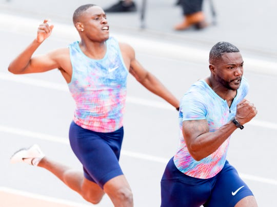 Christian Coleman hands off the baton to Justin Gatlin during an attempt to break the 4x100 relay American record at Tom Black Track at LaPorte Stadium in Knoxville, Tennessee on Saturday, April 14, 2018.