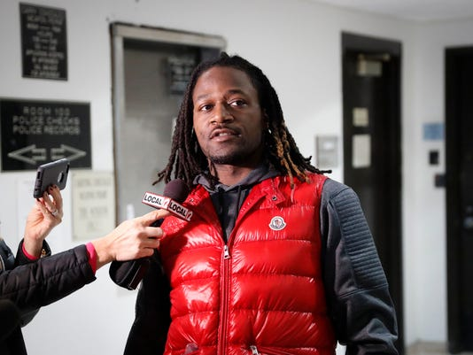 """FILE – In this Jan. 4, 2017, file photo, Cincinnati Bengals cornerback Adam """"Pacman"""" Jones speaks to reporters as he is released from the Hamilton County Justice Center in Cincinnati. A judge in Cincinnati plans a pretrial hearing Tuesday, May 16, in the case of the veteran Bengals cornerback, who faces multiple misdemeanor charges stemming from an altercation at a downtown Cincinnati hotel. (AP Photo/John Minchillo, File)"""