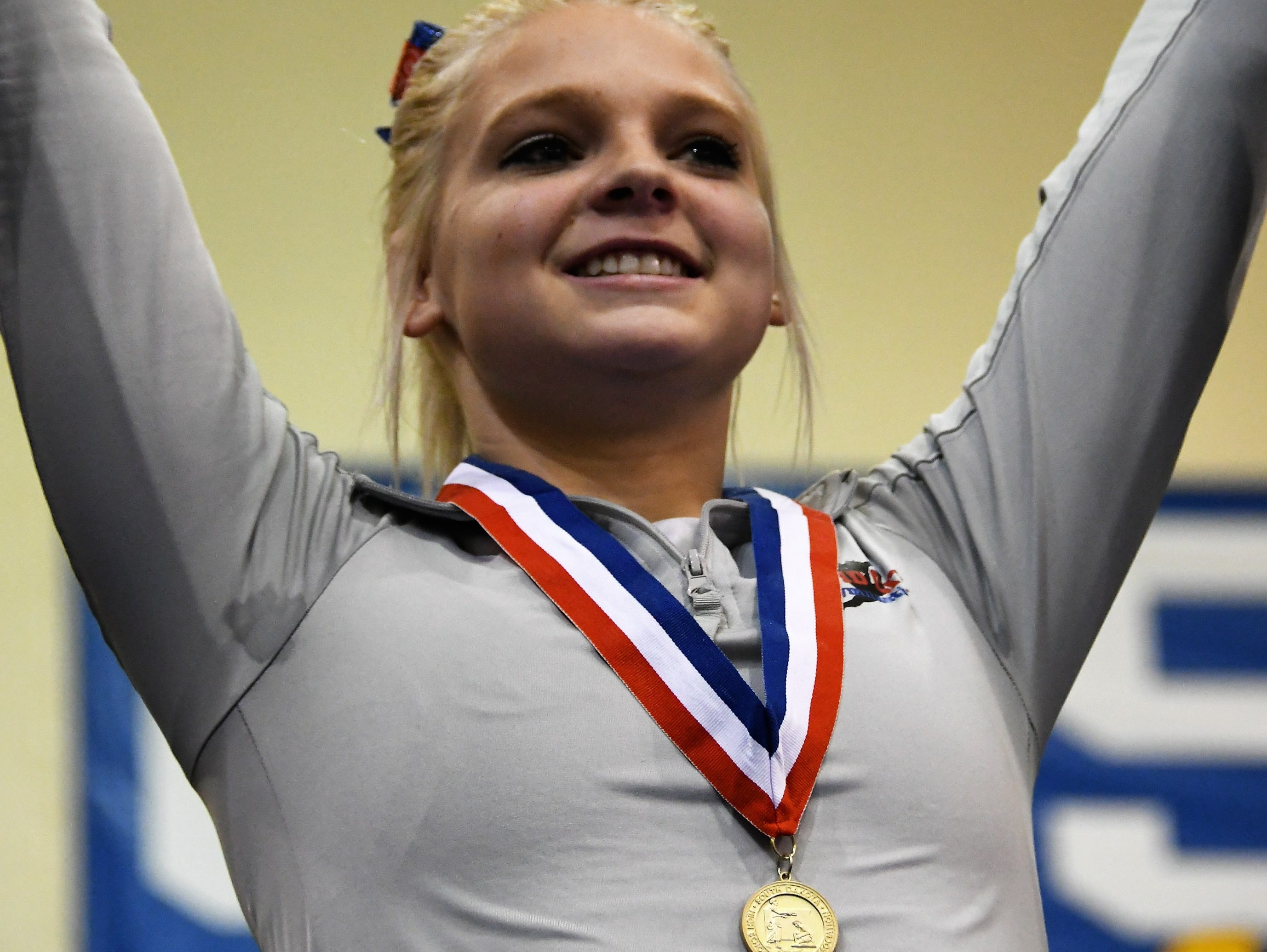 Class AA all around champion Jordyn Huneke of Rapid City Stevens. Huneke finished with a total score of 38.475.