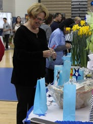 Sandy DiFilippo of Sweet Water looks over the items