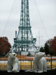 A pair of polar bears are set up near the ice skating