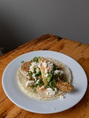 Tortilla shells are doubled up in this fish taco recipe