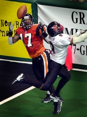 Indiana Firebirds Eddie Brown (#17) keeps his eyes on the ball as he catches it for a second quarter touchdown in front of Orlando's Damon Mason, April 27, 2001 at the Conseco Fieldhouse.