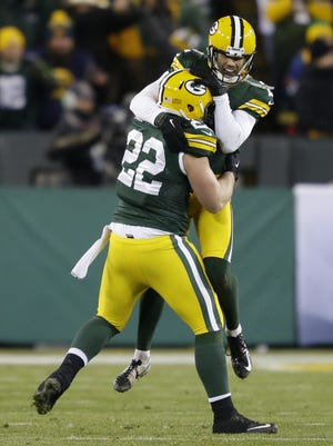 Green Bay Packers kicker Mason Crosby leaps into the arms of Aaron Ripkowski after forcing a fumble on a kickoff return late in the game against the Vikings.    The Green Bay Packers host the Minnesota Vikings Sunday, January 3, 2016, at Lambeau Field in Green Bay, Wis.