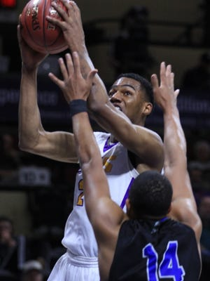 LSUS DJ Clayton goes up for two points in the 2018 NAIA National Tournament in Kansas City.