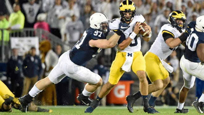 Penn State's Ryan Buccholz sacks Michigan quarterback John O'Korn in the second half of an NCAA Division I college football game Saturday, Oct. 21, 2017, at Beaver Stadium. The No. 2 Penn State Nittany Lions defeated Michigan 42-13, improving their season record to 7-0.