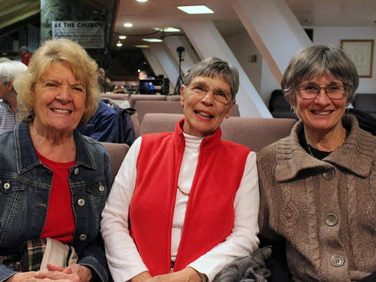 Left to right: Norma Azevedo of Redding, Chris Regnart of Palo Cedro and Kathy Silva of Redding attend the Oaksong Music Society concert with Chuck Brodsky on Jan. 28 at Pilgrim Congregational Church in Redding.