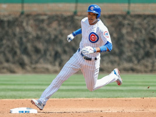 Chicago Cubs shortstop Addison Russell rounds the bases after hitting an RBI-triple off Pittsburgh Pirates starting pitcher Tyler Glasnow during the first inning of a baseball game, Saturday, April 15, 2017, in Chicago. Ben Zobrist scored on the play. (AP Photo/Kamil Krzaczynski)