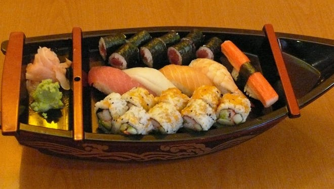 The Sushi Mori B boat at Jao Thai Kitchen features six pieces of sushi plus one California roll and one tuna roll.