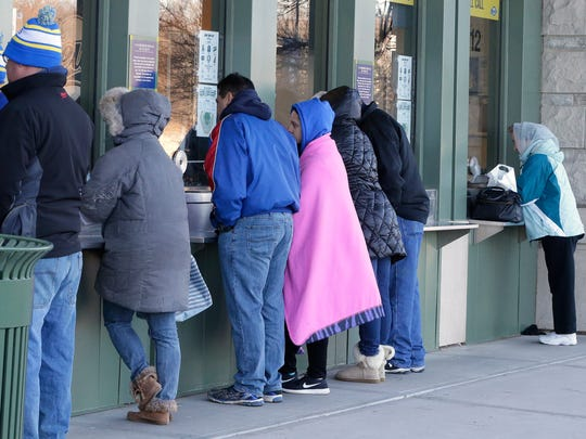 Brewers fans line up at the Miller Park Box Office on Saturday to buy single-game tickets. With temperatures well above February norms in the low 50's, it was more like a late spring gameday than normal. Temps were in the 40s in the morning and mid-50s by the afternoon.