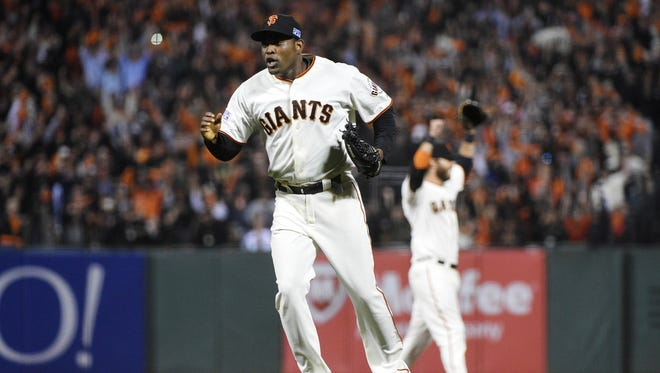 Santiago Casilla celebrates after closing out the Nationals in the ninth inning.