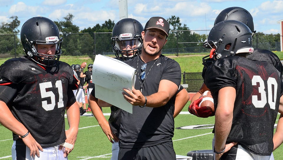 Pinckney assistant coach Cody Patton goes over details