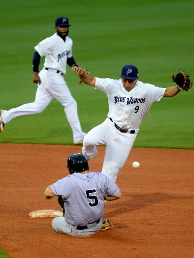 Jacksonville Suns runner Joe Benson gets in the way of Pensacola's Ray Chang and steals second base Monday at Blue Wahoos stadium.