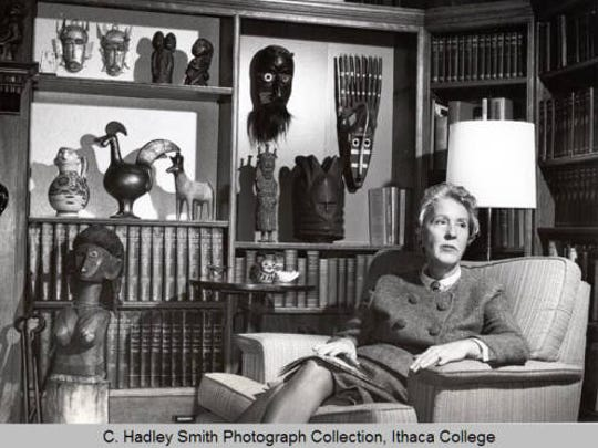 Dorothy Dillingham, wife of the fourth president of Ithaca College, Howard Dillingham, in the study with some art objects collected by the Dillinghams that they donated to the college.