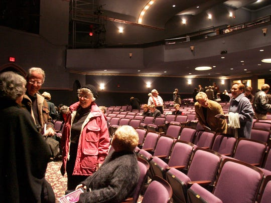 "(File Photo) John and Sandra Hudson, center, talk with friends Peggy Houston, left, and Peggy Scholz shortly after the doors to the house opened at Englert for the play A Christmas Carol. ""Oh, it's beautiful. It's gorgeous,"" said John Hudson, ""We had helped raise money for the Englert so we're doubly pleased."" ""It was a pretty startling transformation,"" said Sandra Hudson, comparing the theatre with before when it had been a two-screen movie theatre."