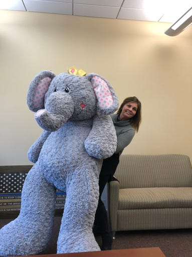 Karen Hogue, right, poses with Officer Elli Phant.
