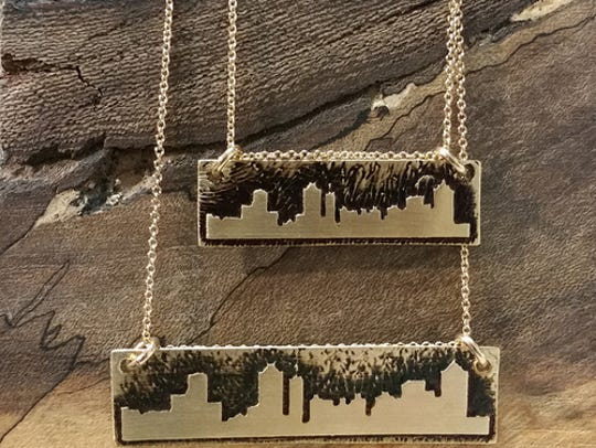 Necklaces like this Nashville skyline one are a good