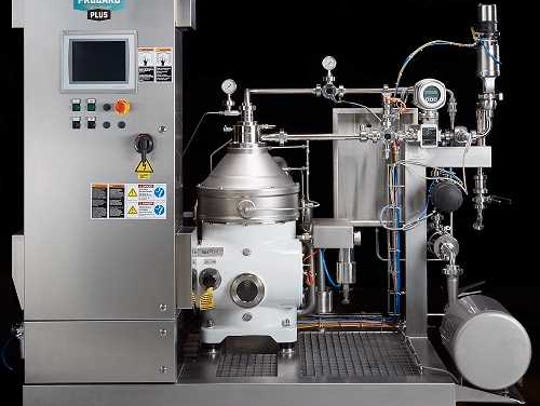This machine adds carbonation to beer while reducing