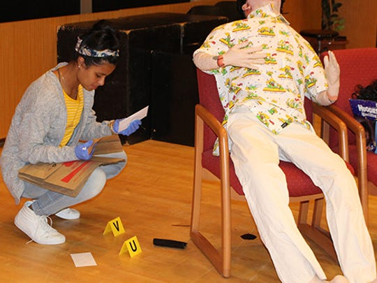 "Tagging, documenting and collecting evidence at the ""murder"" scene is just one part of Stockton CSI Summer Camp."