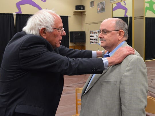 Democratic presidential candidate Bernie Sanders talks to Cathedral City Council member Greg Pettis during a rally near San Diego Saturday night.
