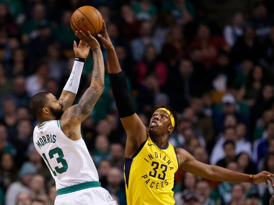 Boston Celtics forward Marcus Morris (13) is defended