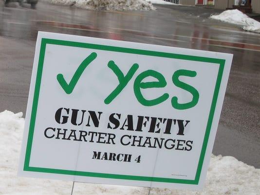 Gun safety sign