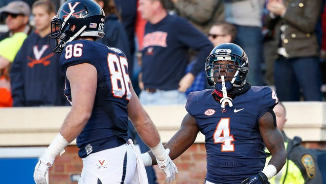 Nov 21, 2015; Charlottesville, VA, USA; Virginia Cavaliers running back Taquan Mizzell (4) celebrates with tight end Charlie Hopkins (86) after scoring a touchdown in the first half against the Duke Blue Devils at Scott Stadium. Mandatory Credit: Amber Searls-USA TODAY Sports