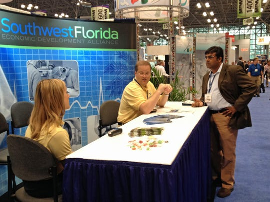 Southwest Florida Economic Development Alliance member John Cox talks about the business climate with Amit Singh, an Iselin, N.J., businessman attending the Medical Device Manufacturing trade show in New York City.