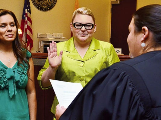 Headlight File Photo   Mayra Solis, left, and Jessica Moreno took the oath to become Court Appointed Special Advocates (CASA). Administering the oath was Sixth Judicial District Court Judge Jennifer DeLaney.
