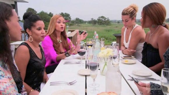Real Housewives of Potomac eating dinner at Bluecoast Seafood Kitchen.